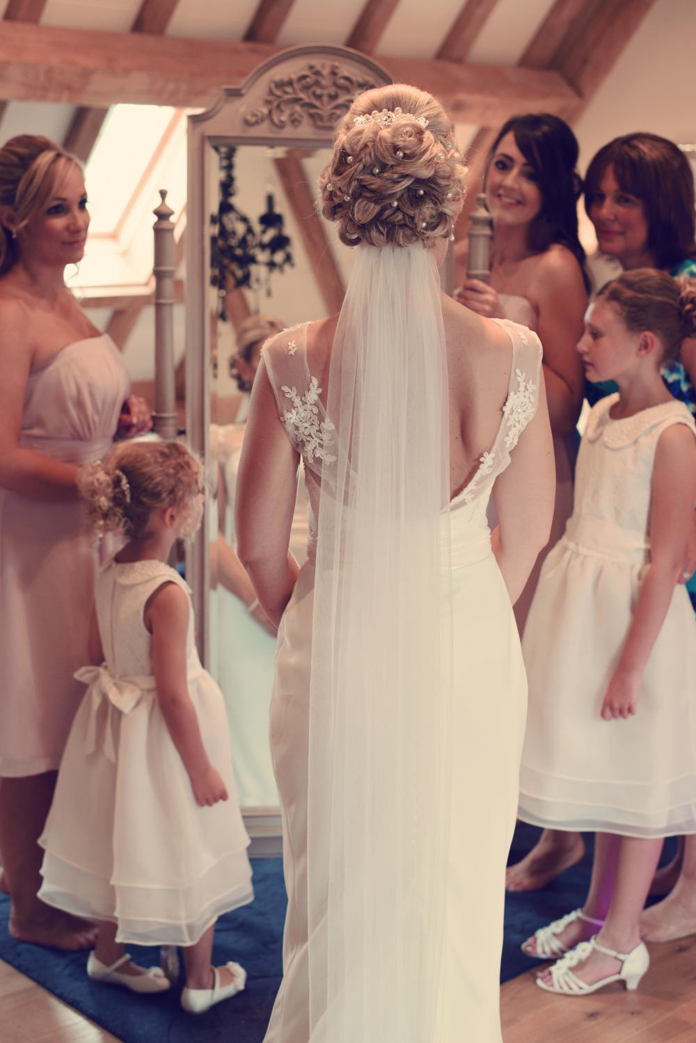 The Girls Admiring the Beautiful Bride