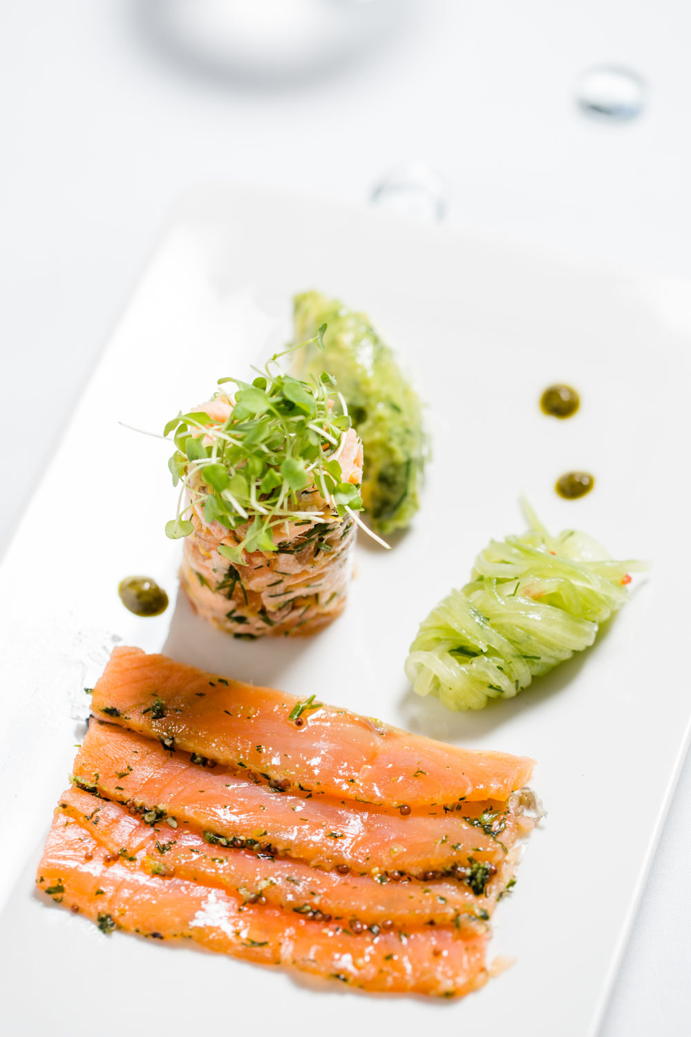 Home cured gravlax & smoked trout with crushed avocado & cucumber pickle